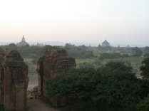 The sun going down in Bagan (our bikes are parked at the gate)